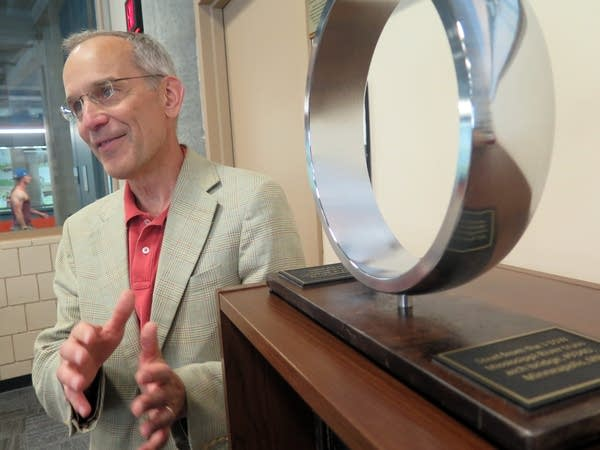 U of M engineering prof. Joe Labuz with a ring from I-35W bridge remnants.