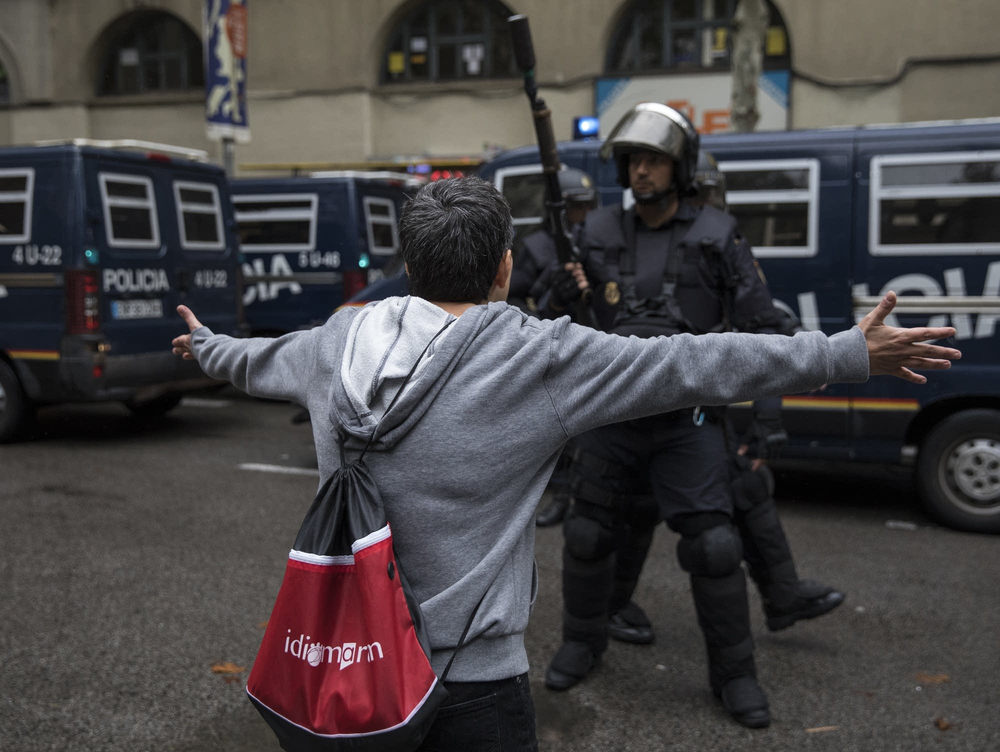 Pro-Referendum supporters clash with members of the Spanish National Police