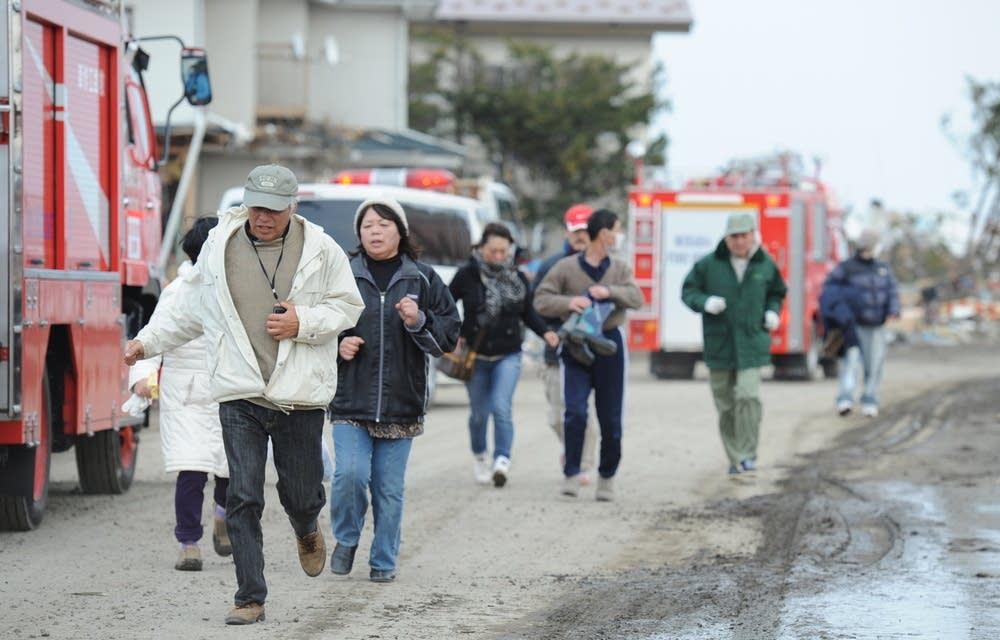 Residents run inland after a tsunami warnings