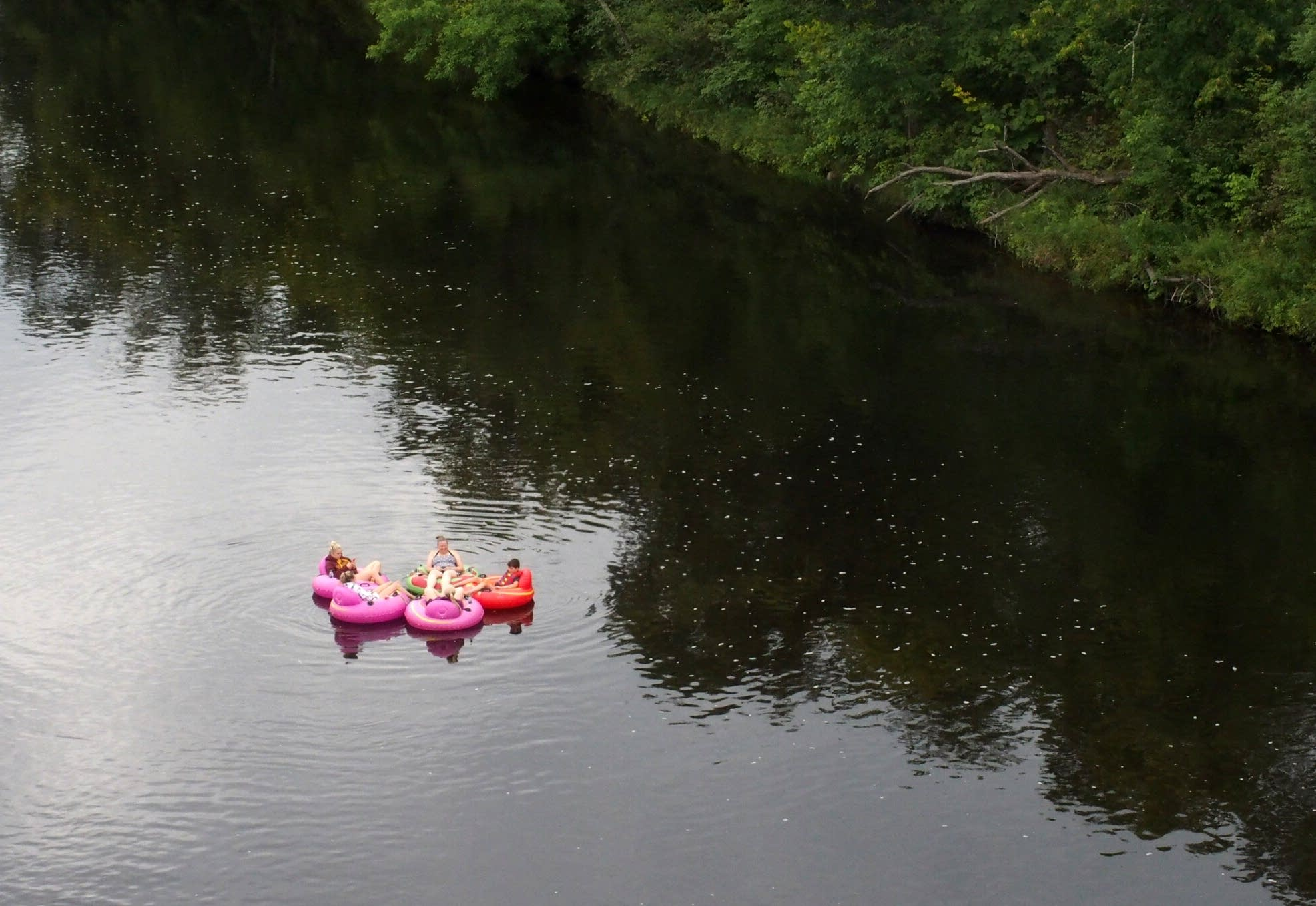 A group looks for the eclipse as they float down the St. Croix.