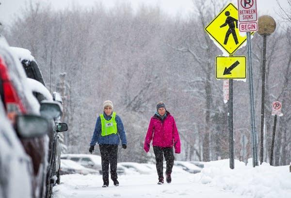 Janet Stone and Judy Harvey walk at University of Minnesota Duluth campus.