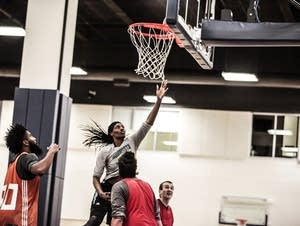 Sylvia Fowles jumps as she tries to catch the basketball.