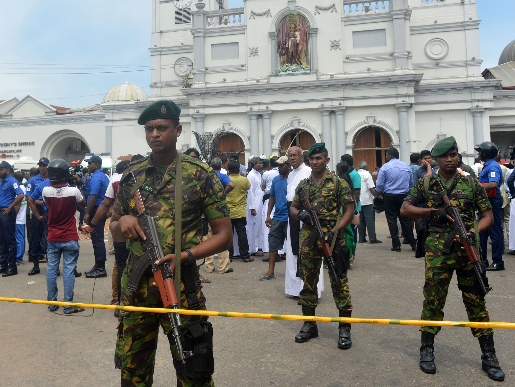 Sri Lankan security personnel keep watch outside a church