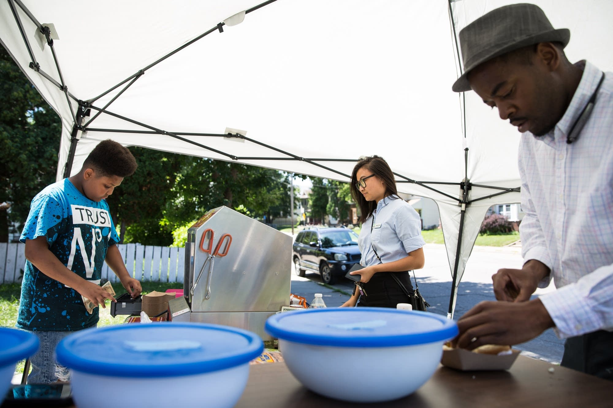 Jaequan Faulkner serves customers from a stand in front of his house.