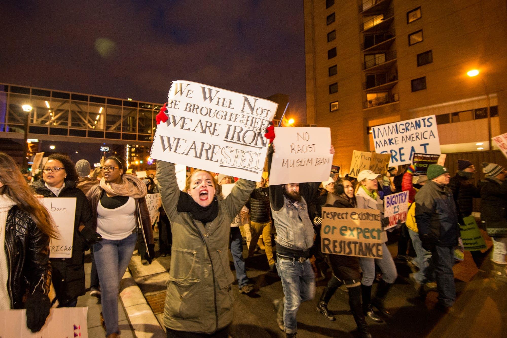 Protesters make their way down Washington Avenue