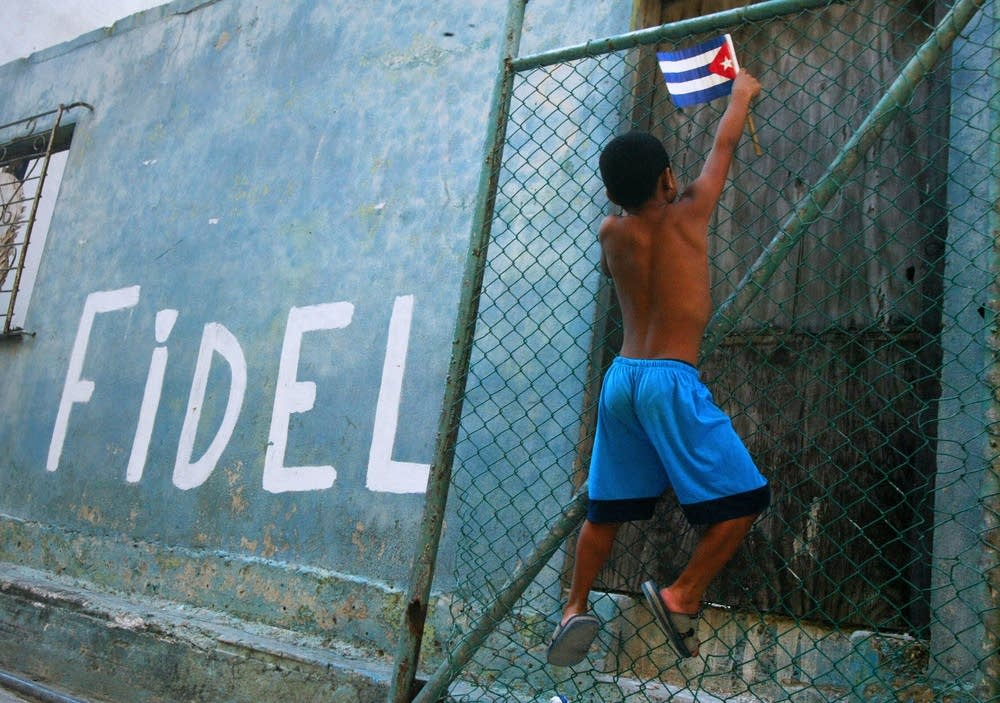A Cuban child holding a national flag