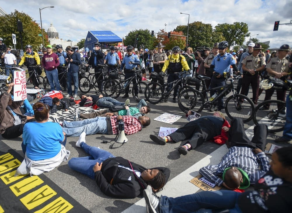 Police officers use bikes to block protesters