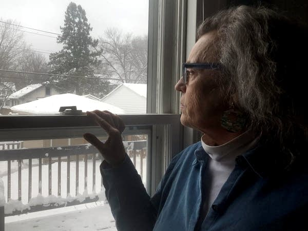 Karbon of St. Paul looks at snow that fell during an April snowstorm