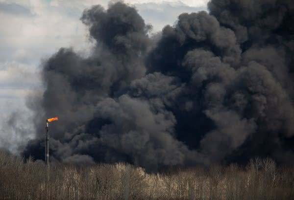 Black smoke rises from the site of the Husky Energy oil refinery Thursday.