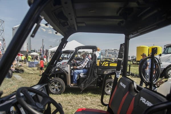 Farmers look and get to try gear out at Farmfest.