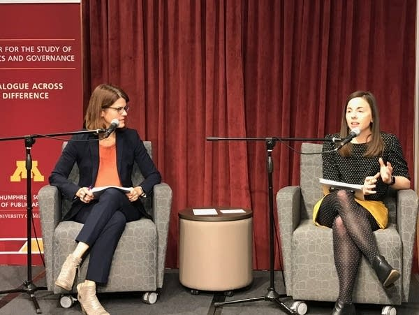 Two women on stage for a panel discussion.