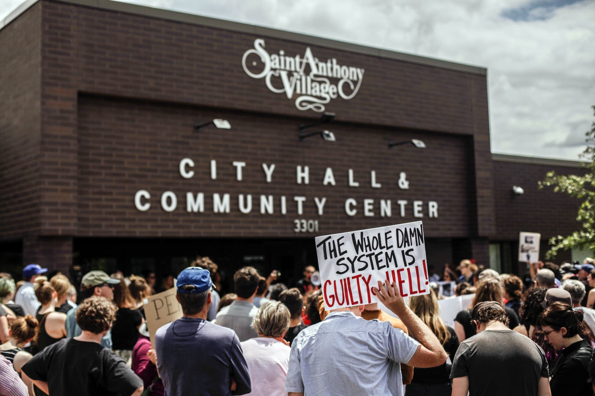 About 250 people gathered outside St. Anthony City Hall to protest Sunday.