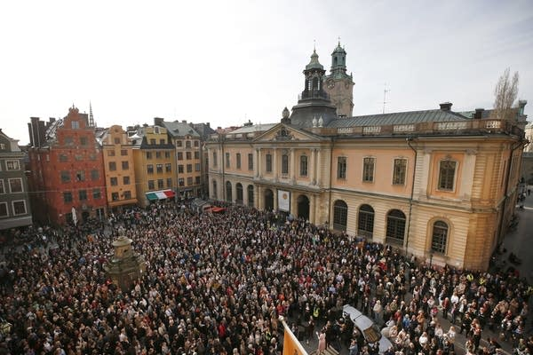 A large crowd gathers in the Stortorget square in Stockholm.