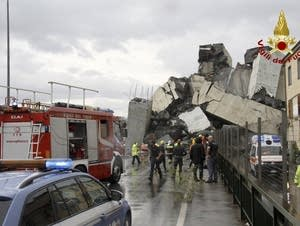 Rescuers work among the rubble of a collapse bridge.