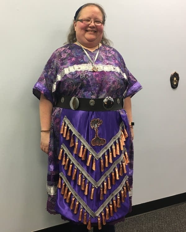 A woman in a jingle dress.