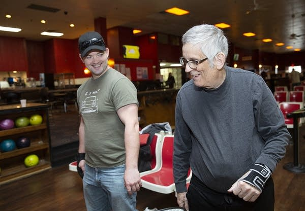Patrick Belcher and Garry Nims joke while bowling.