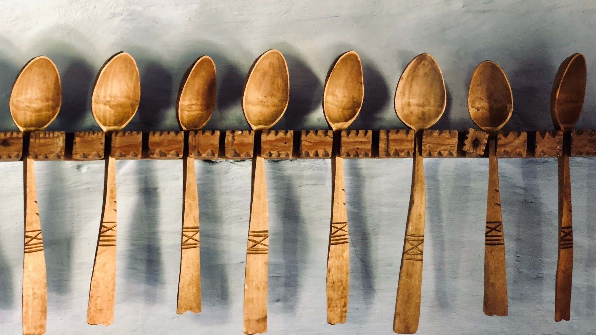 Wooden spoons hanging in a row