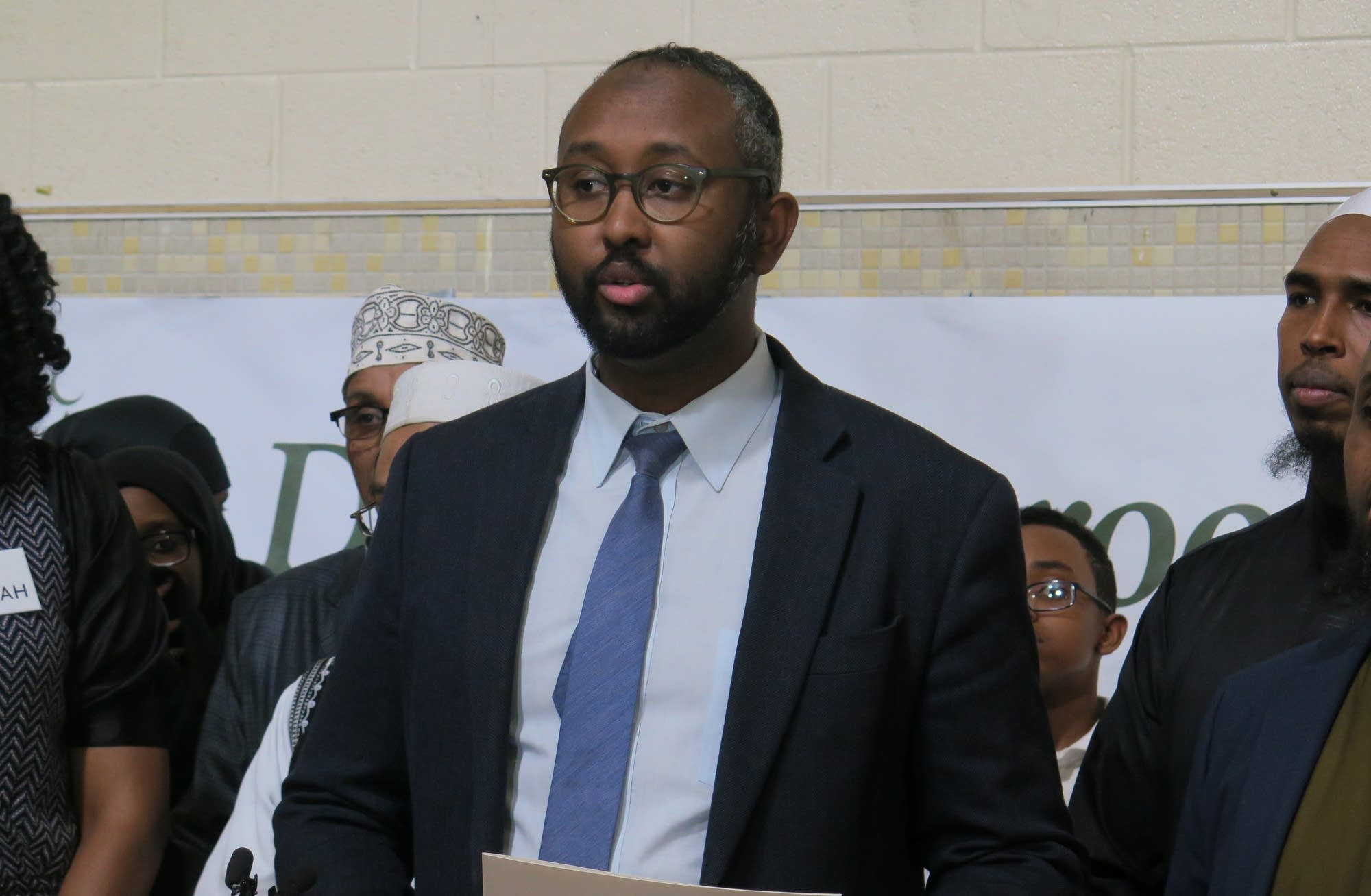 Jaylani Hussein speaks at a press conference
