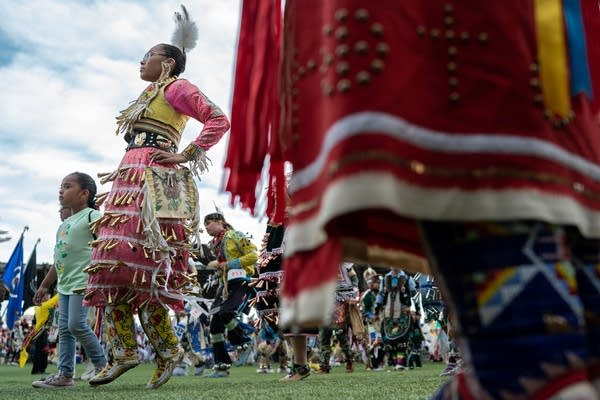 Jingles Dress dancers circle the Grand Casino Hinckley powwow grounds.
