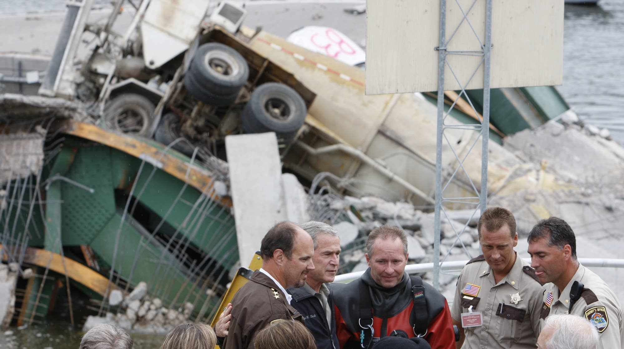 George W. Bush meets rescue workers at the bridge site.