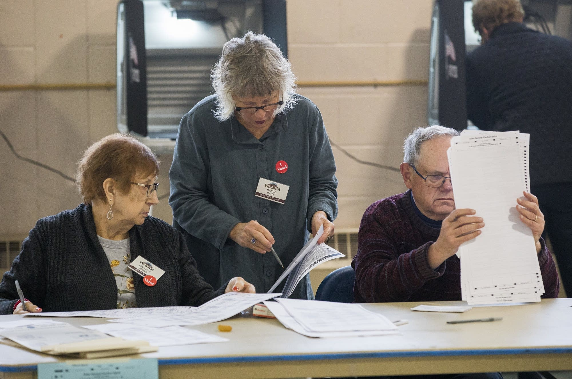 Election judges at the Miners Memorial Building in Virginia, Minn.