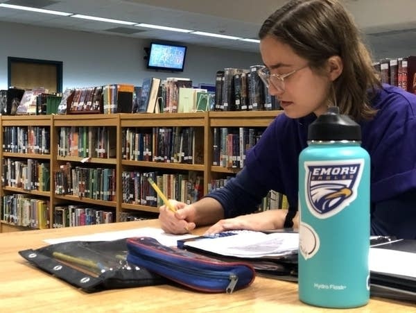 Cayanne Korder, 18, studies in the Red Wing High library