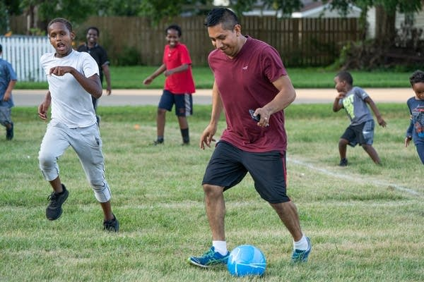 Humberto Hernandez plays soccer with neighborhood kids.