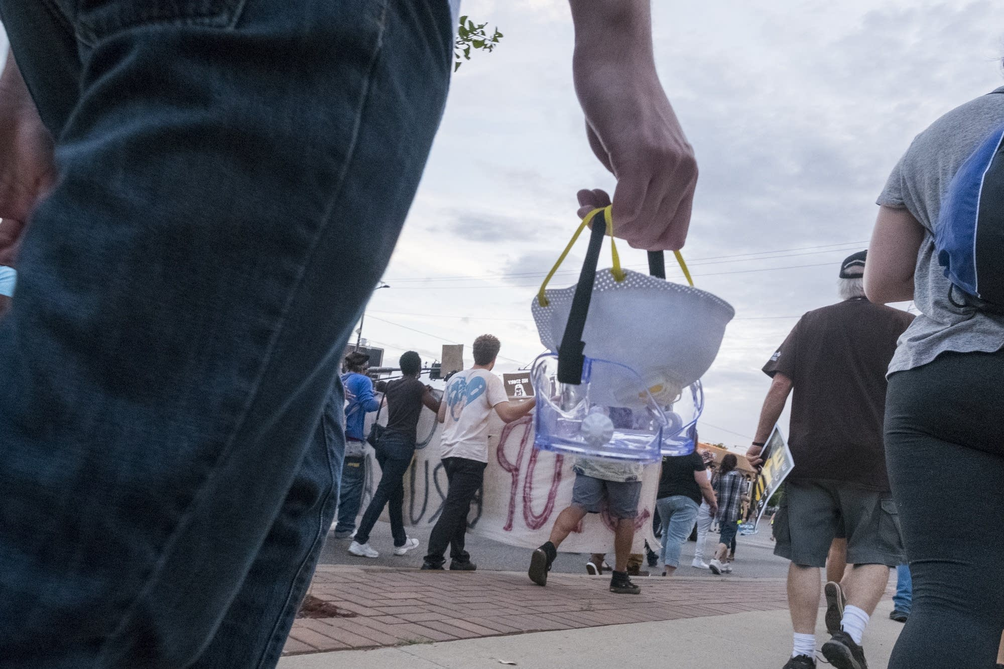 Protesters carry protective gear.