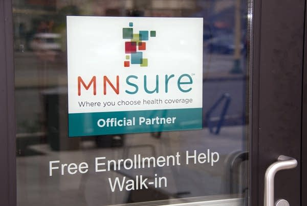A sign on the door of Briva Health, MNsure's largest enrollment partner.
