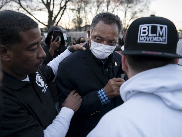 The Rev. Jesse Jackson meets with demonstrators