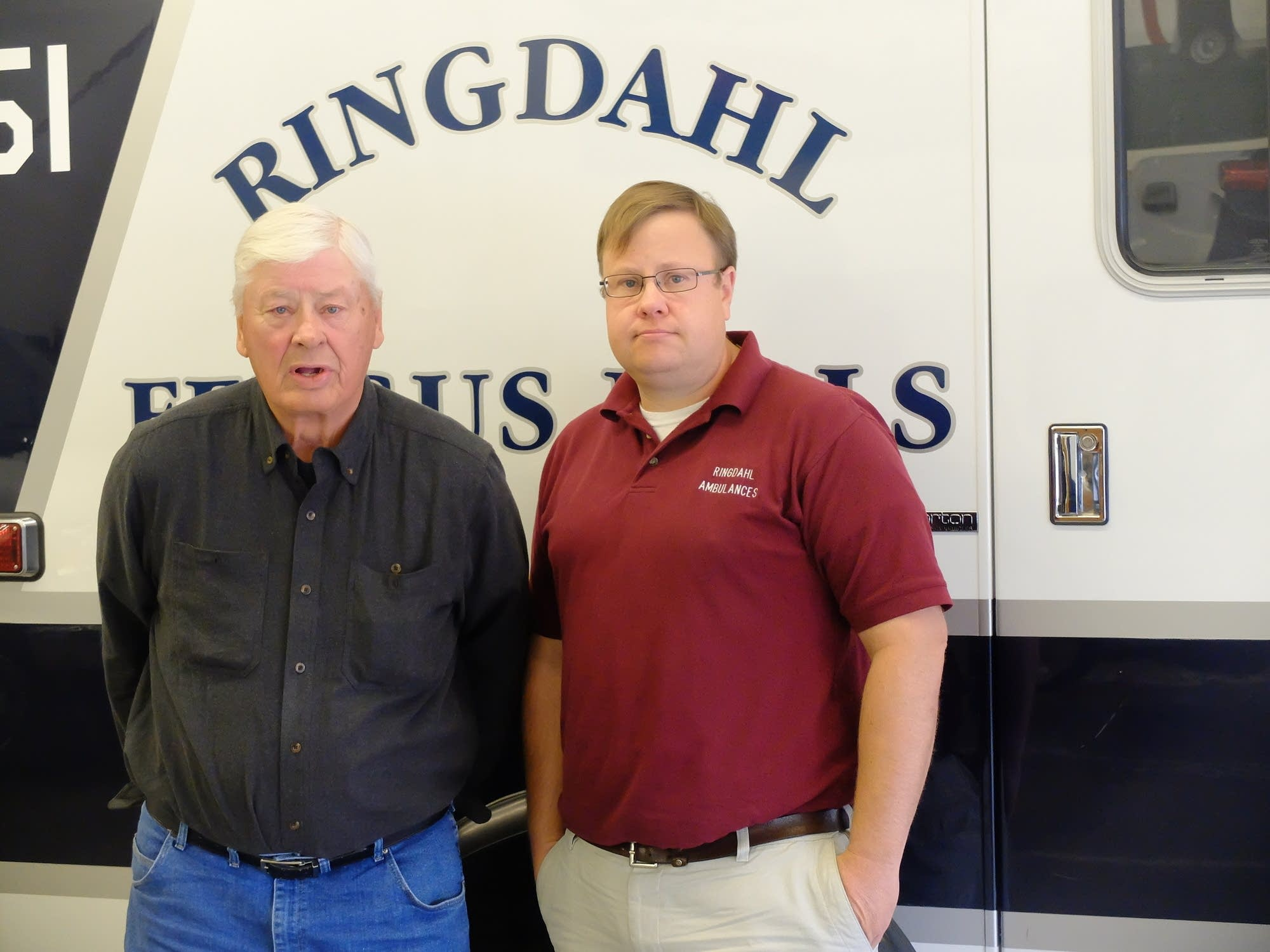 John Ringdahl and his son Tollef pose next to one of their ambulances.