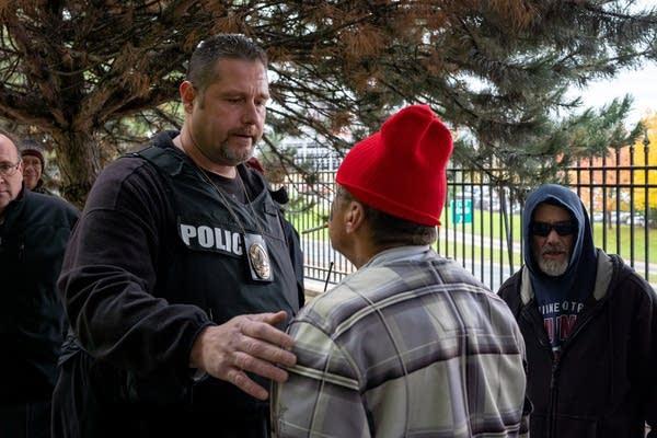 St. Paul Police officer Dean Koehnen talks to Jesse Fenny.