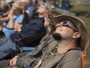 Eclipse watchers stare into the sky as they wait for the total eclipse.