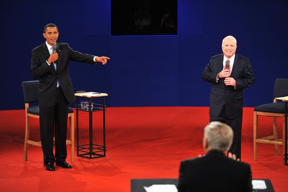 Barack Obama (L) makes a point to the audience