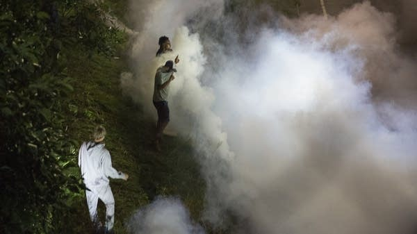 Protesters are hit with smoke bombs