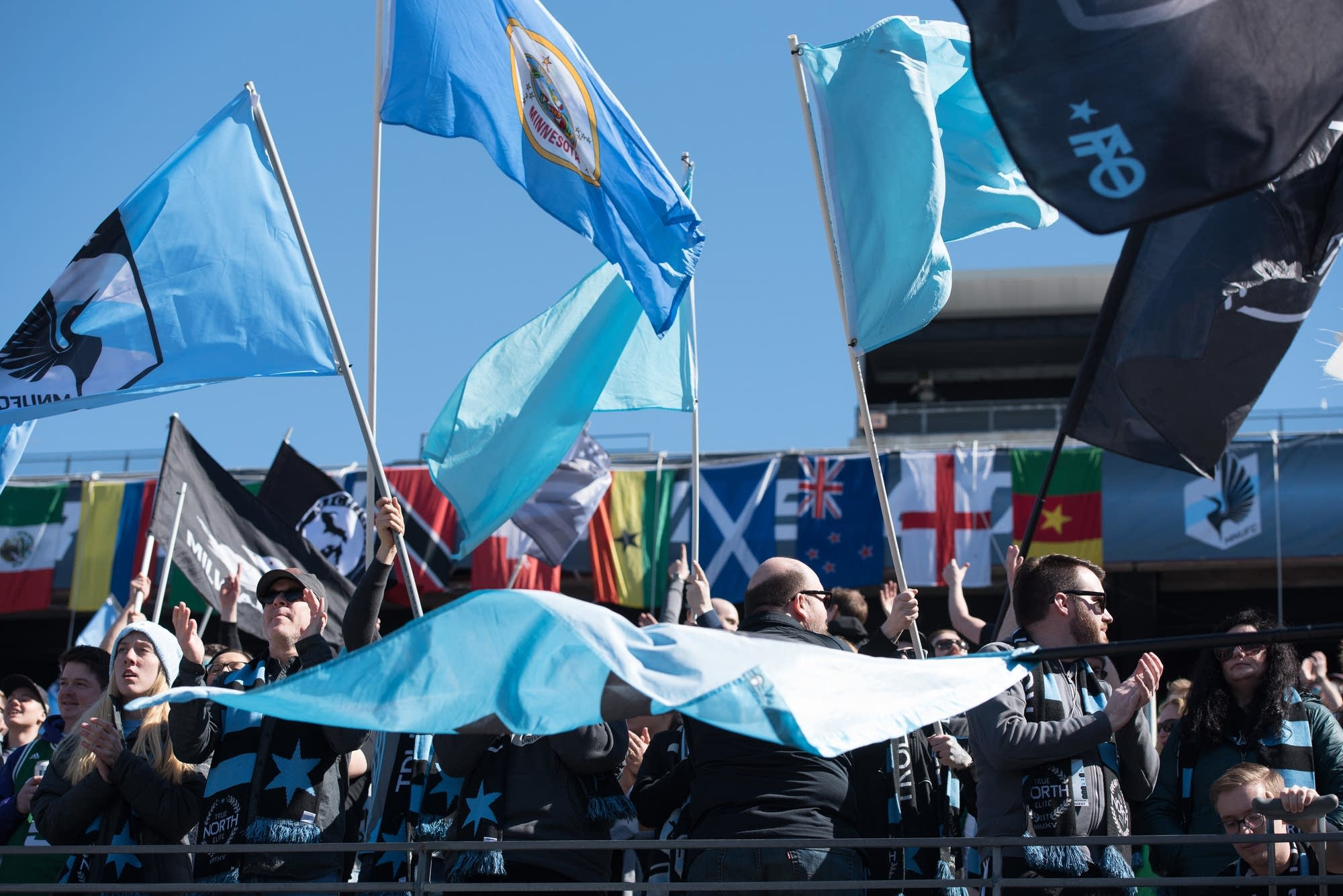 Fans unfurl many flags to support the Loons.