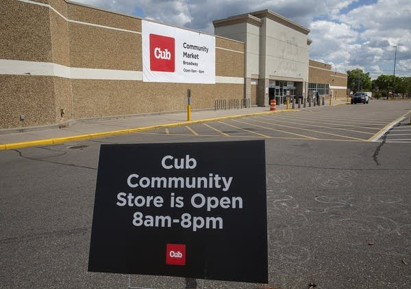 A sign reads Cub community store is open 8 am-8 pm