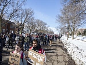 Students march down Marshall Ave. in St. Paul