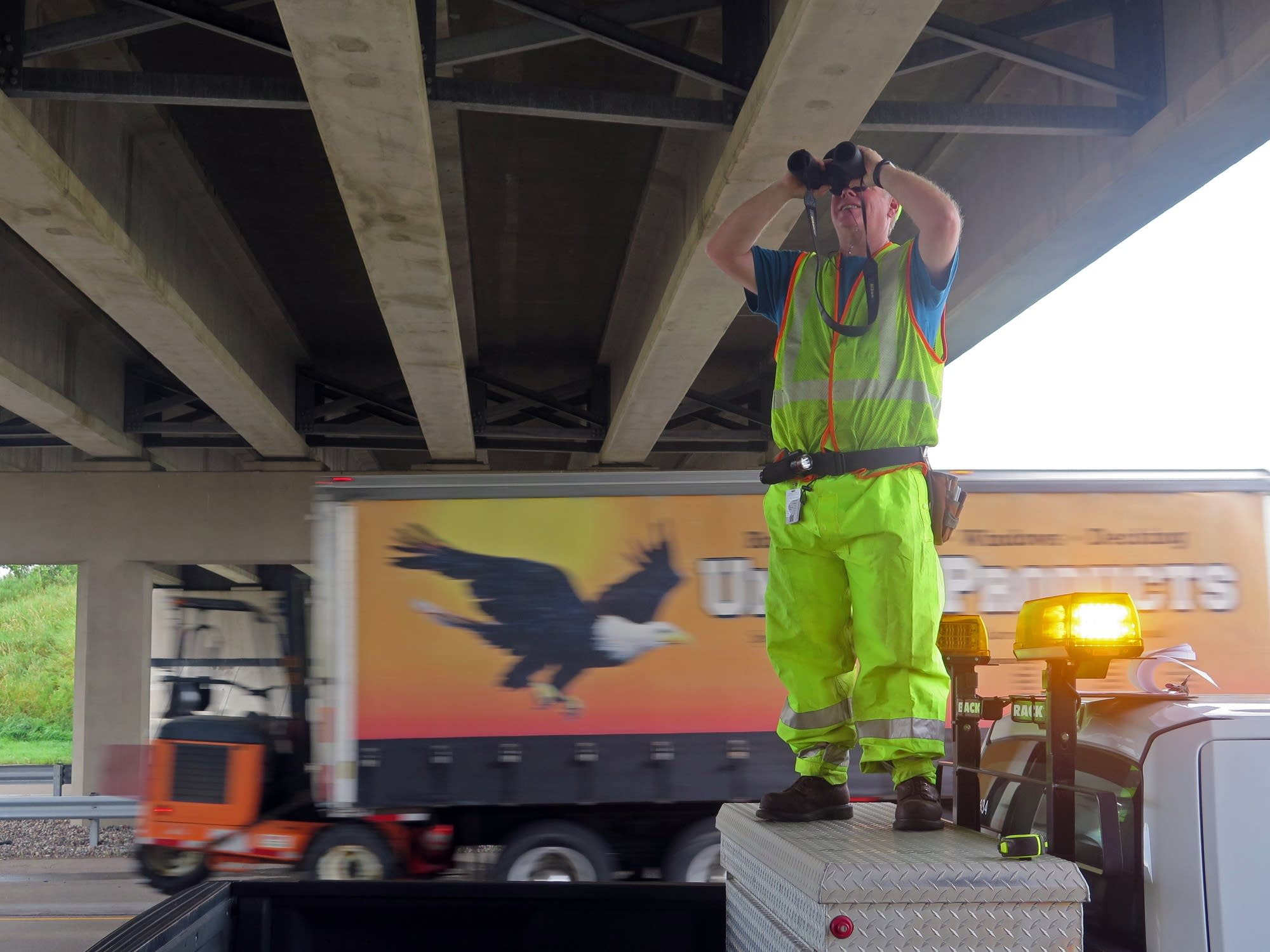 Brad Dumbeck inspects a bridge over Highway 610 in Brooklyn Park.