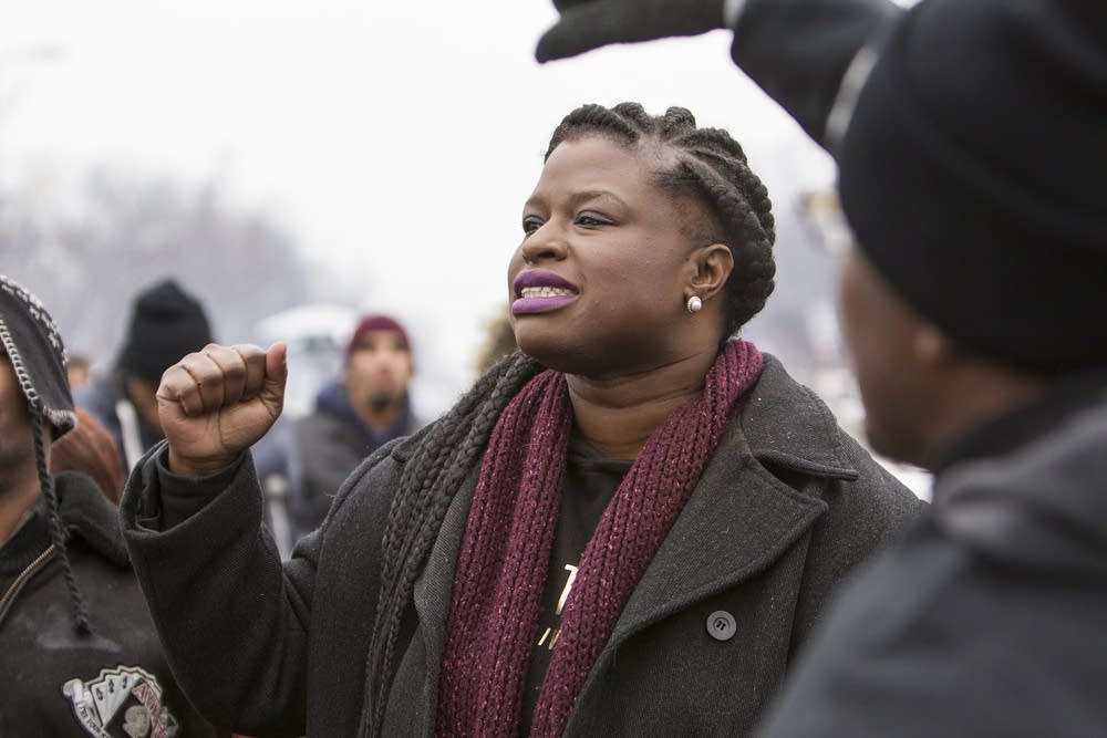 Nekima Levy-Pounds chants with activists.