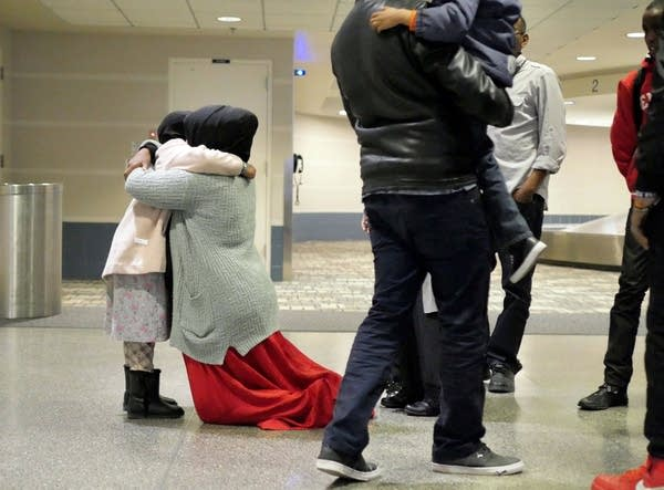 Muha Yasin hugged her daughter after she and her brother arrived.