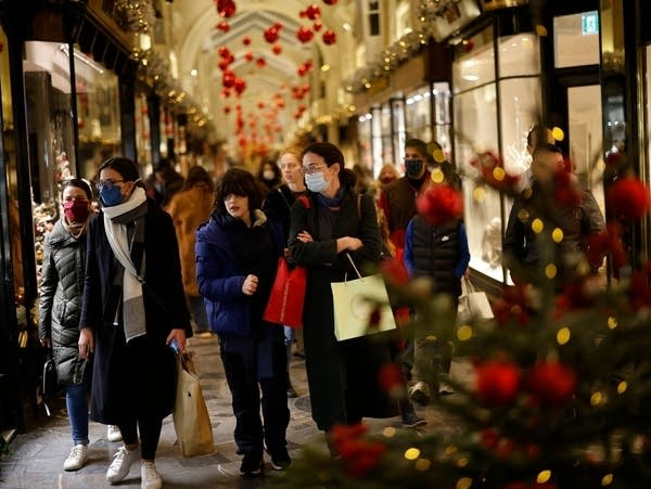 Shoppers look at shop window displays