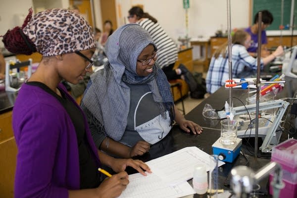 Women work in a science lab.
