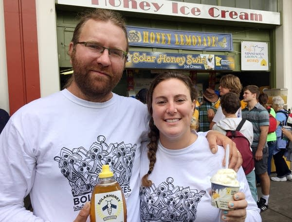 Travis and Chiara Bolton stand in front of the Solar Honey Swirl ice cream.