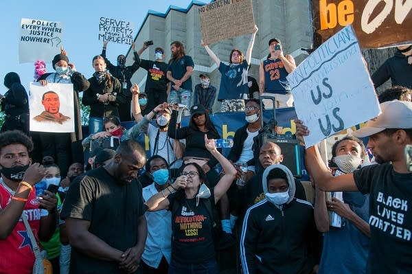 Protesters chant in honor of George Floyd at 5th Precinct