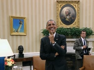 Barack Obama in Oval Office with photographer Pete Souza