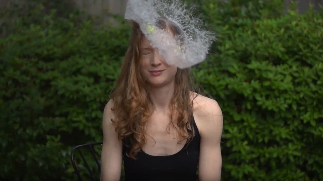 Violinist Adriane Post of the Diderot Quartet is hit with a water balloon.
