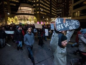 Protesters in Minneapolis rally against immigration ban.