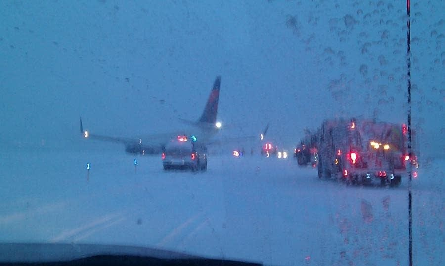 Delta flight slides off taxiway