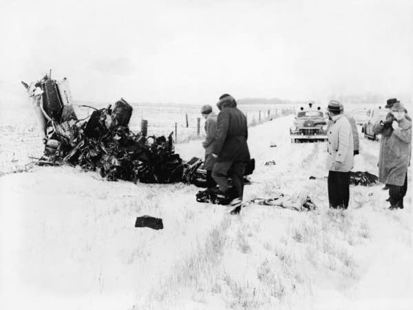 A group of men at the crash site in February 1959